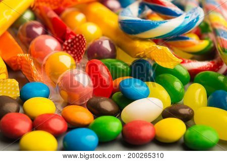 Candies On Grey Background With Selective Focus In The Foreground