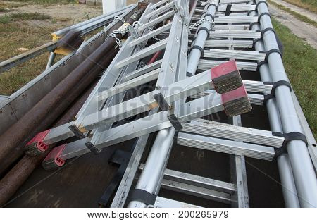 Construction ladders prepared for transport on a caravan