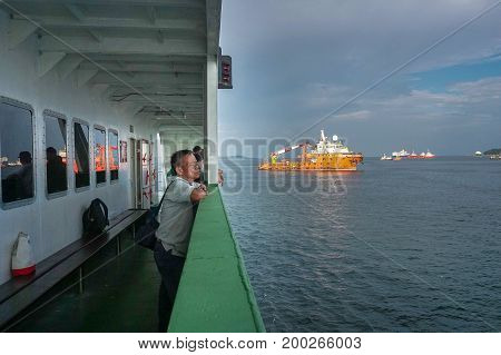 Labuan,Malaysia-July 23,2017:Passenger on upper enjoying the view while departure from Labuan island to Menumbok,Sabah.This is the economical transportation to the Labuan Pearl of Borneo
