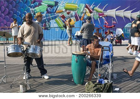 BROOKLYN NEW YORK USA - AUGUST 16: Men playing percussion instruments on Coeny Island boardwalk. Taken August 16 2017 in New York.