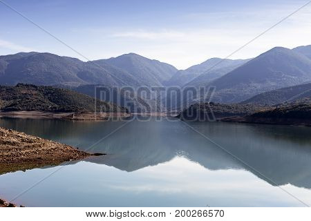 The panoramic view of mountain lake and mountains
