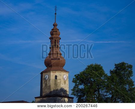 Tower of old church in small town