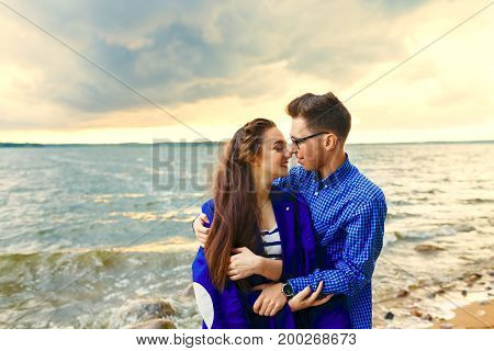 Young couple love each other on the beach