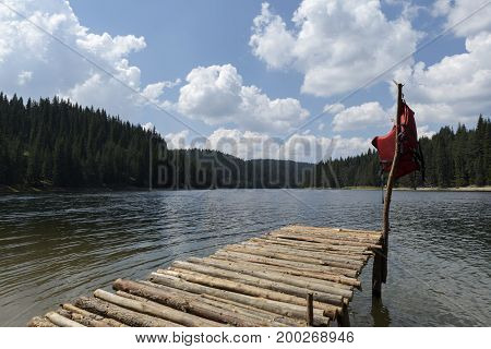Water horizon in an alpine lake. Mountain