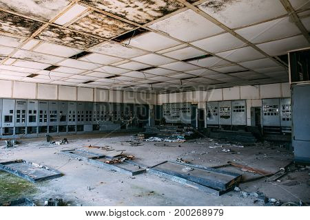 Ruins of the control center in an abandoned factory, large empty old room