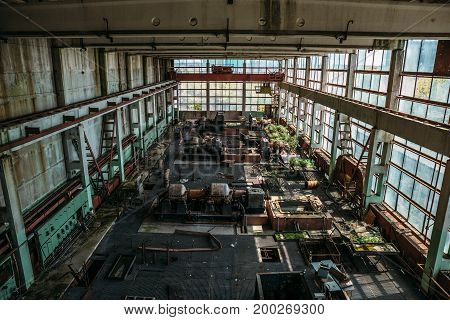 Large old workshop in an abandoned factory, abandoned industrial concept, toned