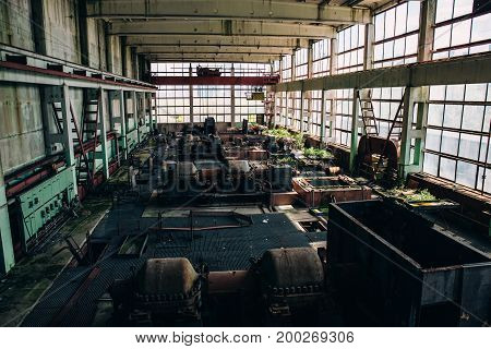 Old abandoned industrial factory interior workshop, forgotten places concept, toned