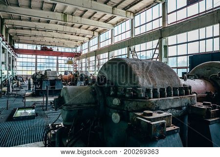 Large machines and equipment at an abandoned factory in the city of Efremov, Russia