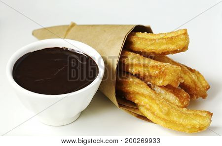 Traditional mexican dessert churros with chocolate sauce