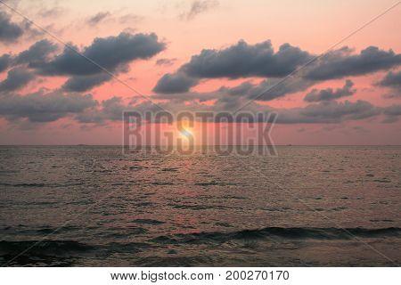 Dark sunset sky over a calm sea.