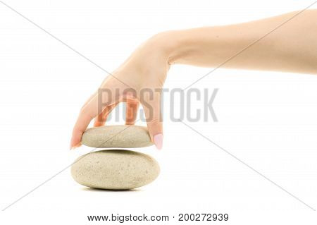 Stones large pebbles in female hands on white background isolation