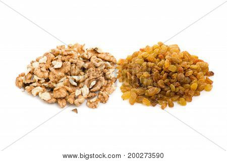 Raisins and walnuts isolated on white background isolation