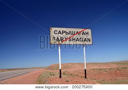 Road sign.Area of former Soviet  anti-ballistic missile testing range.Kazakhstan.May 6, 2017.Sary Shagan.Kazakhstan