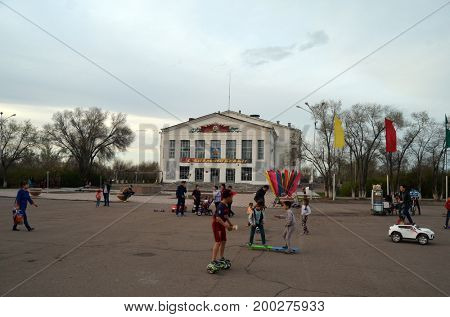 Officers club of former Soviet anti-ballistic missile testing range Sary Shagan.Poster - V-day congratulations (RU).May 8, 2017.Priozersk.Kazakhstan