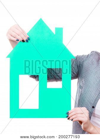 Ownership property concept.. Human hands holding green paper house model cutout. New flat apartment. Isolated on white