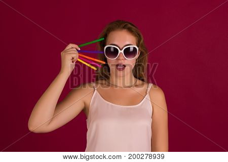 Young cute woman with markers, studio, beautiful girl
