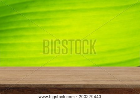 Perspective wooden table on top over blur natural background can be used mock up for montage products display or design layout.