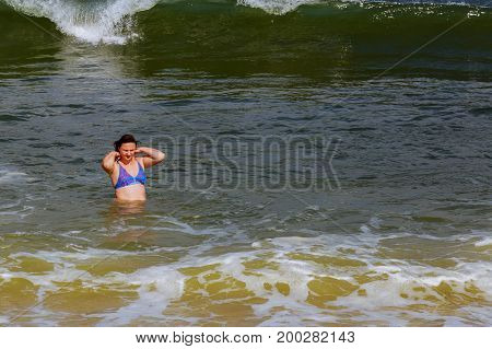 Beautiful Brunette Woman Run Blue Ocean