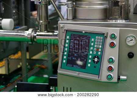 Modern industrial equipment in food production factory. Selective focus.