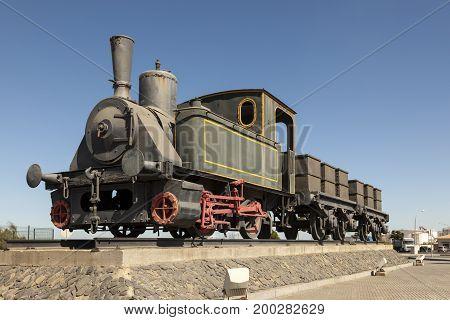 Old historic steam train in the port of Huelva Spain
