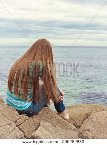 Sad girl sitting. Lonely woman is sad