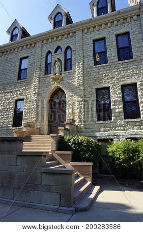JOLIET, ILLINOIS / UNITED STATES - JULY 18, 2017: The stairway leads to an entrance of the historic Welcome Center, at the University of Saint Francis.