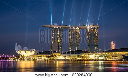SINGAPORE - 11 SEPTEMBER 2016 : Marina Bay Sands at night during Light and Water Show 'Wonder Full'. The landmark is considered the personification of Singapore.