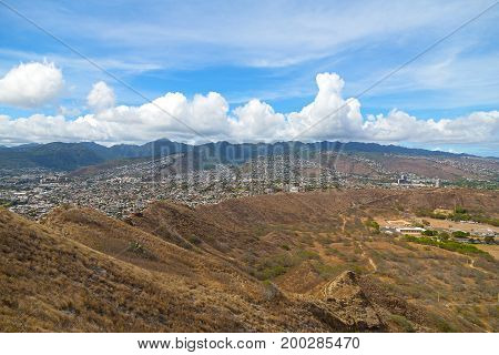 Oahu island terrain and view on suburban Honolulu Hawaii USA. Panorama of Pacific Island with mountain ridge on horizon.