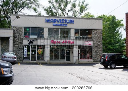 CREST HILL, ILLINOIS / UNITED STATES - JULY 19, 2017: One may buy smoking accessories at the Headventure Smoke Shop and Gallery, women's clothing at Sheez All That, and skateboards at Jeric's Skateboard Shop, in the Key Plaza.