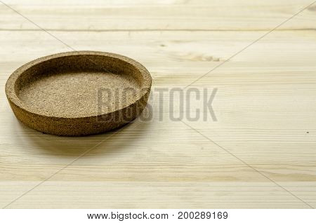 Coaster or glass pad made from rubber on wooden background