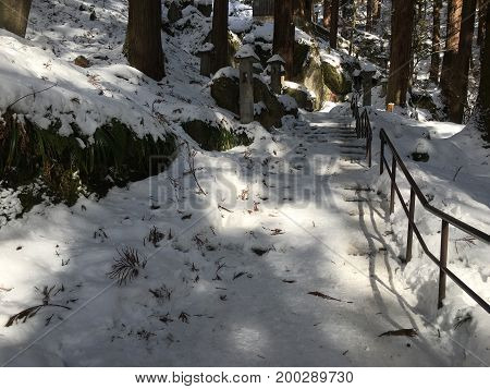Iced stairs at Yamadera Risshaku buddhist temple under snow in Yamagato Japan during winter