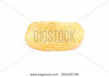 Single potato chip isolated on white background close-up