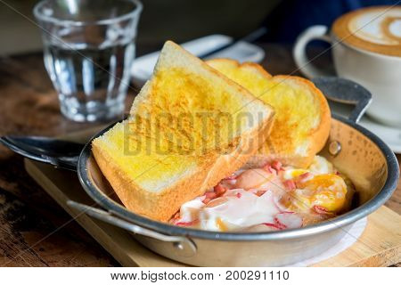 Egg pans with baked bread simple breakfast.