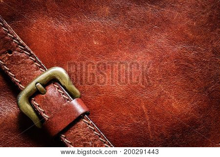 Leather background with excellent texture for design  and a leather belt with a buckle