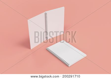 Two Notebooks With Spiral Bound On Red Background