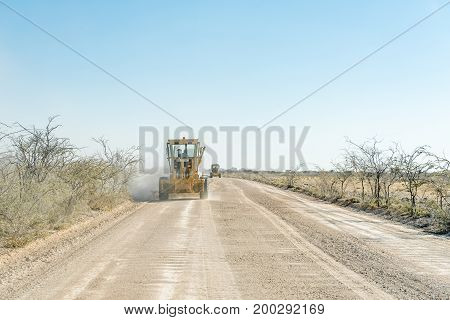 ETOSHA NATIONAL PARK NAMIBIA - JUNE 23 2017: Road graders rehabilitating the gravel road between Okaukeujo and Halali in the Etosha National Park of Namibia
