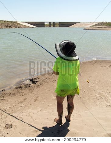 The girl is fishing for the bait .