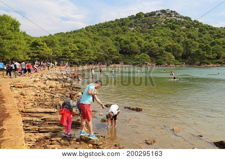 DUGI OTOK, CROATIA - SEPTEMBER 7, 2016: This is rest with a dip in the salt lake Mir in the Telascica Nature Park.