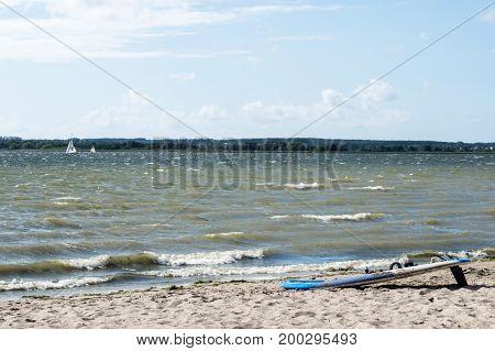 Colorful Windsurf Board On A Golden Beach