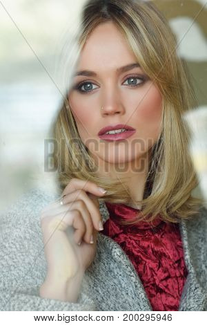 Thoughtful Young Blonde Woman With Lost Eyes From The Window