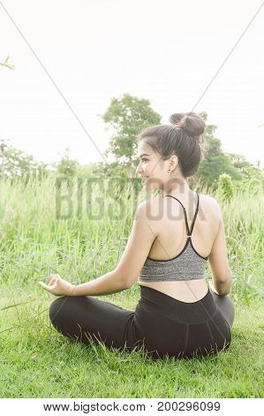 Young woman practicing yoga Everyday Yoga helps in concentration breath shape body strength help skin brighten. Among the Dharma Air in bright days