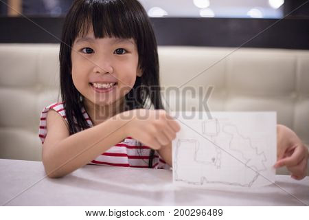 Asian Chinese Little Girl Drawing On Paper