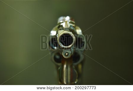 revolver gun muzzle ready to shoot on black background