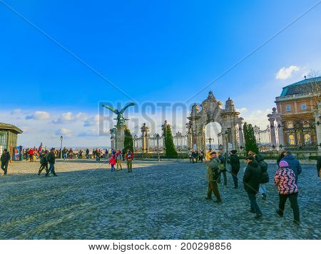 Budapest, Hungary - January 3, 2015: The people going near Bronze eagle statue at Buda Castle Gate in Budapest at Hungary