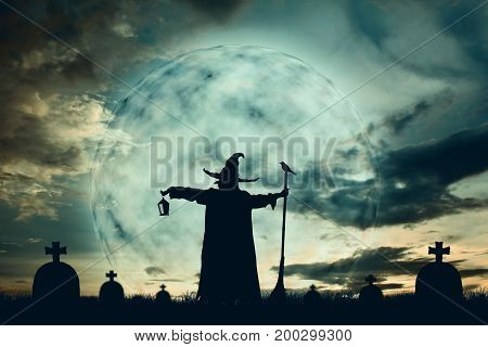 Silhouette of wizards at moonlight background color vintage style Halloween concept