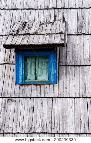 Old Blue Window On Wooden Shingles Roof House