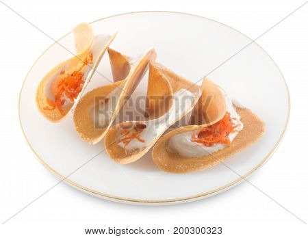 Thai Traditional Snack and Dessert Plate of Crispy Pancake or Crepes Filled with Sweet Coconut Cream and Salted Shredded Coconut Isolated on White Background.