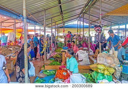 WELLAWAYA SRI LANKA - DECEMBER 2 2016: Rows of vegetable stalls in Wellawaya market neighbors with stalls offer dried fish on December 2 in Wellawaya