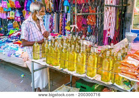 The Oil Merchant In Wellawaya Market