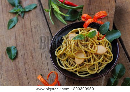 Spaghetti sausage stir fried with curry Thai style.